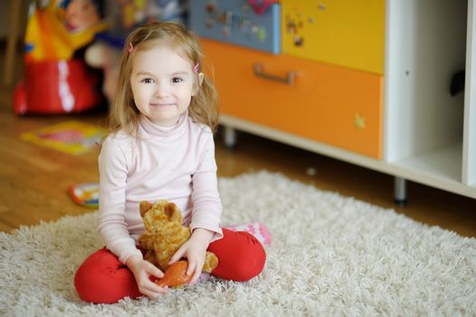 Cheerful child holding a toy