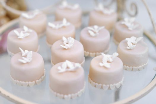 Decorated cupcakes on a glass plate