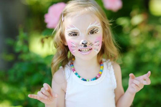 Adorable little girl with painted face