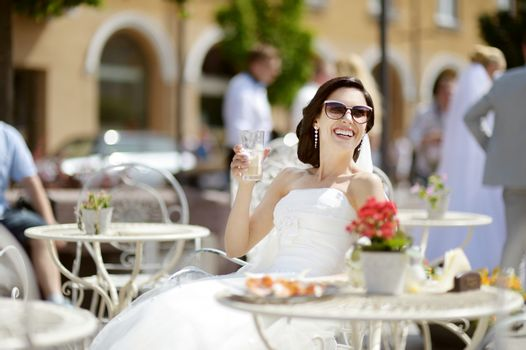 Bride drinking coffee outdoors