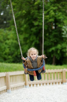 Swinging preschooler having fun