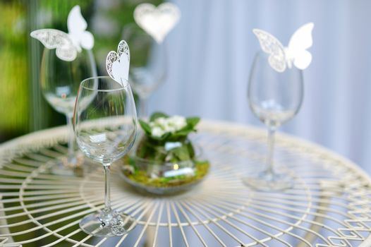 Some wine glasses decorated with butterflies