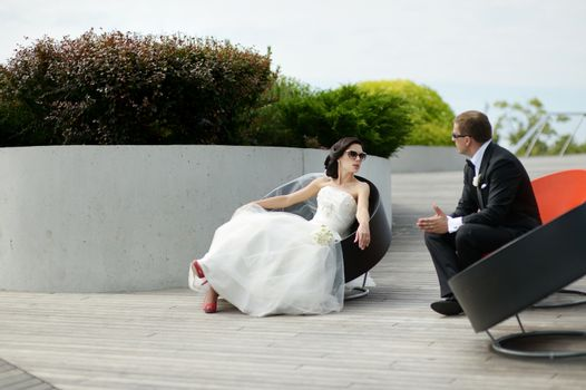Bride and groom in a city