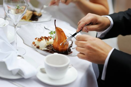 Poached pear with an ice cream in red wine