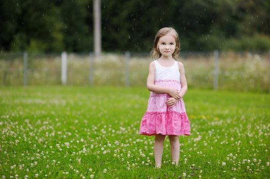 Little girl under the rain