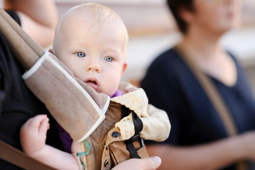 Baby girl in a baby carrier