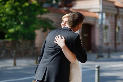 Just married couple hugging