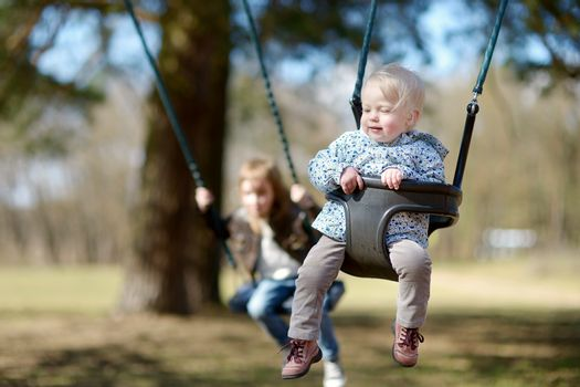 Swinging sisters having fun
