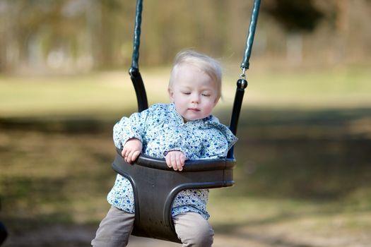 Swinging toddler having fun