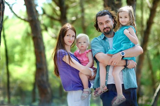 Family of four at summer day