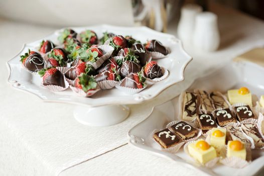 A plate of chocolate covered strawberries