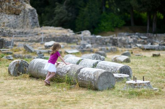 A girl sightseeing historical ruins of Asclepieion