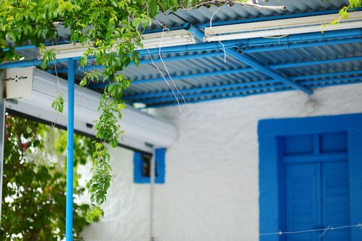 Typical greek white and blue courtyard