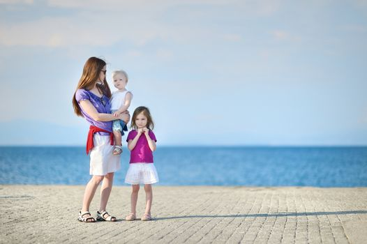 Mother and her kids by a sea