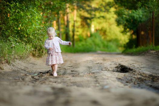 Little girl having a walk in the woods