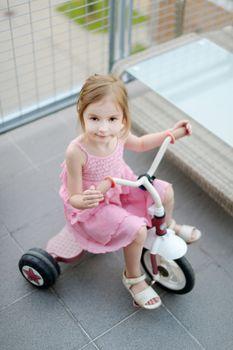 A girl on a small bike