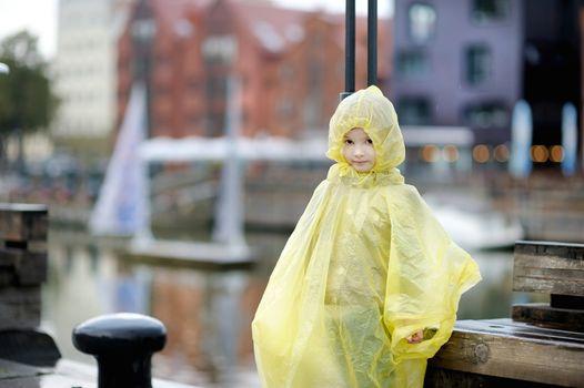 Adorable little girl in a rain coat