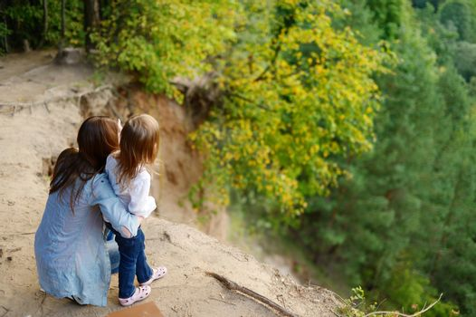 A girl and her mother standing on the edge