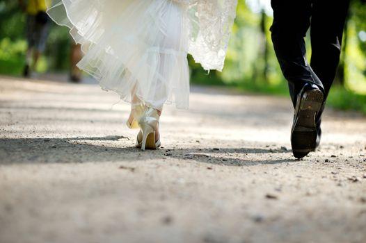 Bride and groom legs