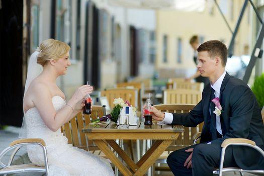 Bride and groom having a refreshing drink