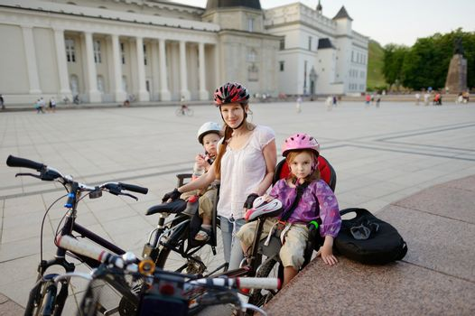 Urban biking - young mother in a city