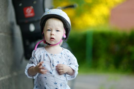 Little girl ready to ride a bicycle