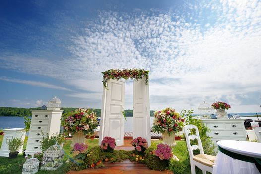 White fancy door as a wedding arch