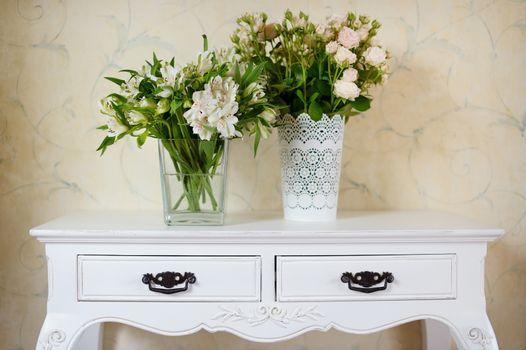 White vase full of white flowers