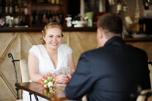 Bride and groom drinking coffee