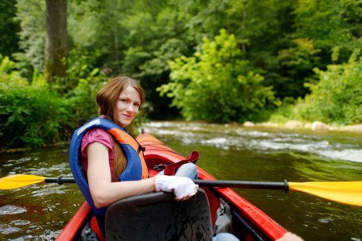 Young woman on a kayak
