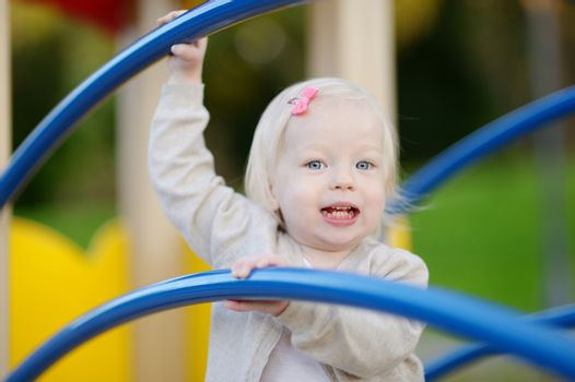 Little toddler girl having fun