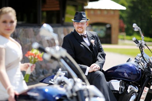 Groom riding a motorcycle
