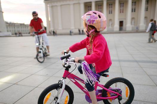 Adorable girl riding a bike