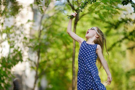 Adorable girl having fun outdoors