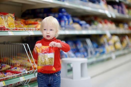 Adorable girl shopping