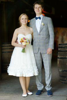 Indoor portrait of a beautiful bride and groom