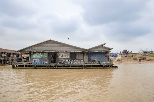 Building (home or grocery?) floating on Siem Reap river going to Tonle Sap lake, a famous tourist destination of Siem Reap Province, Cambodia