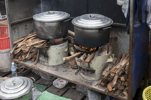 Fish cooking station on wood fire at the famous Crab Market of Kep, Cambodia