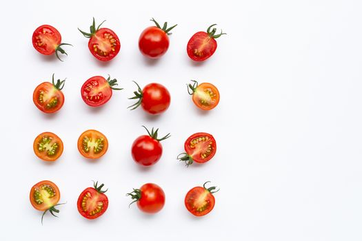Fresh tomatoes, whole and half cut isolated on white background. Copy space