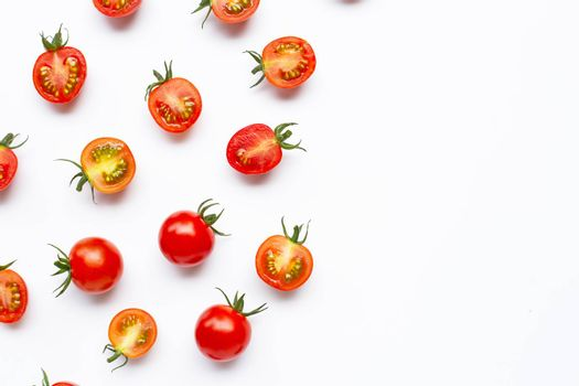 Fresh tomatoes, whole and half cut isolated on white background. Top view