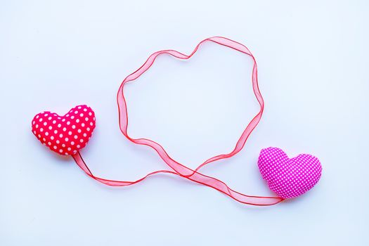 Valentine's hearts with ribbons on white background