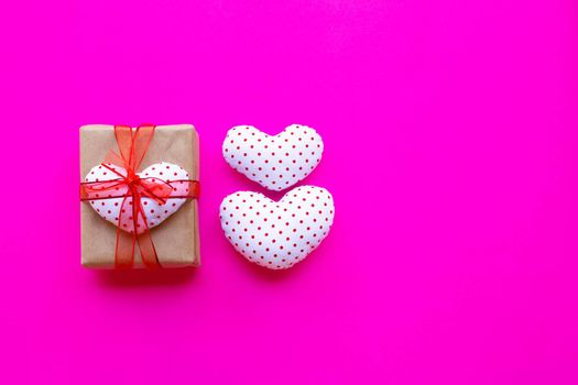 Valentine's heart with gift box  on pink background. Top view