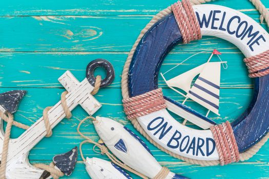 Vintage style of seashore decors on blue wooden background.