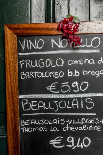 A menu of french and italian wines, on blackboard.