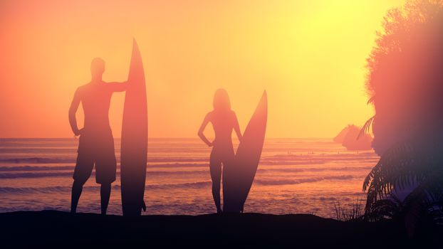 Silhouettes of surfers lit by the setting sun.