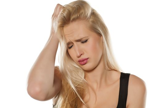 Young blond with headache