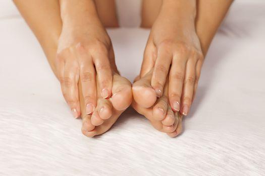 woman massaging her tired feet