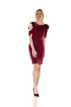 attractive blonde in a short burgundy dress