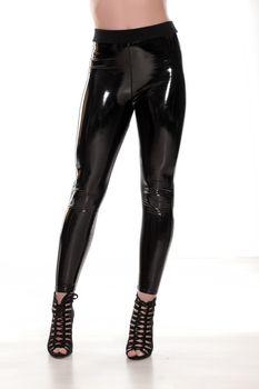 black shiny leggings and high heels