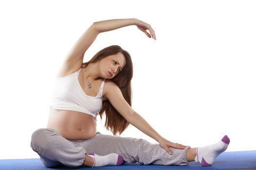 Pregnant woman doing exercises